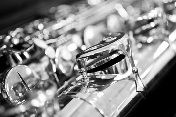 Wall Mural - Fragment of the saxophone valves closeup in black and white