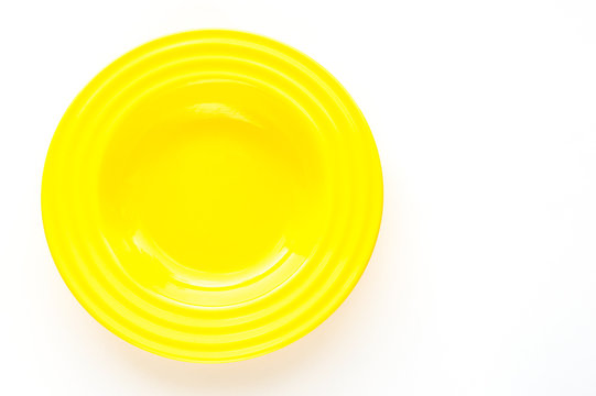 Yellow plate on white background