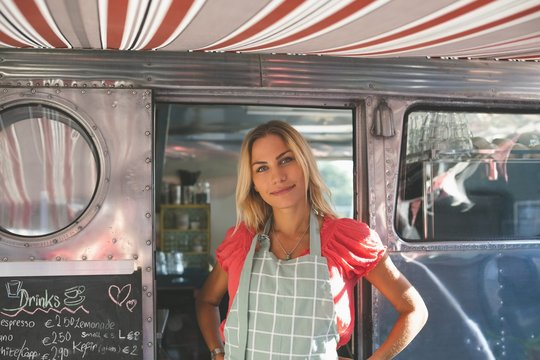 Female waitress standing in food truck