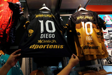 """A shop vendor shows a Dorados soccer club jerseys for sale with the name """"Diego"""" and number """"10"""" in Culiacan, Mexico September 10, 2018. Argentine soccer legend Diego Maradona has been appointed coach of Mexican second division team Dorados"""