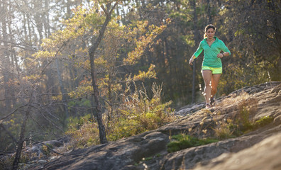Woman trail running at Moss Rock Preserve in Hoover, Alabama, USA