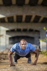 Man exercising under bridge, Birmingham, Alabama, USA