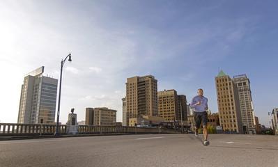 Man jogging on street in city, Birmingham, Alabama, USA