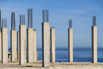 concrete pillars with sea in the background, concrete formwork