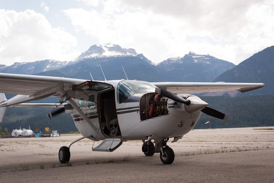 Aircraft parked for servicing near hangar