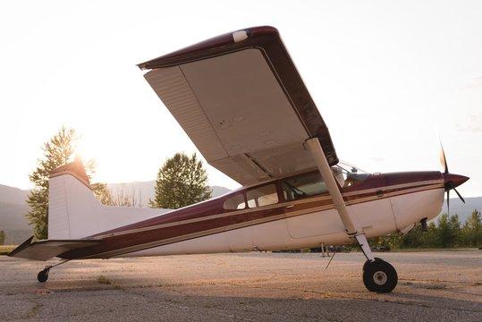 Aircraft parked near hangar