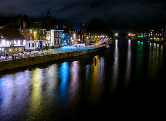 Night View Of York Along The River Ouse With Colourful Reflections  In The Water