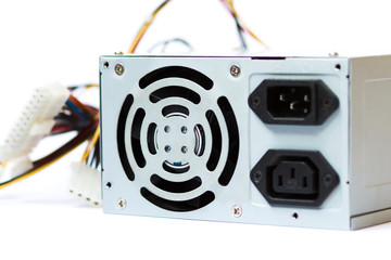 grey power supply for the computer with cables unit for pc on white background
