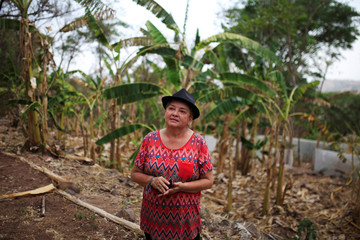 Lidia Urias poses for a picture on her farm in San Isidro