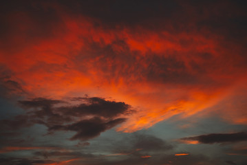 evening sunset sky with clouds illuminated by the sun