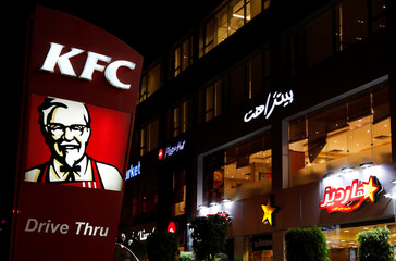 Logos of fast food restaurants KFC, Pizza Hut and Hardee's are seen at Americana Plaza Mall in Cairo