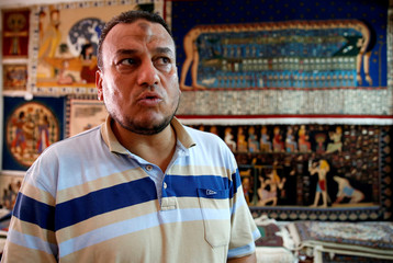 Saleh Bakr, head of Saqqara Carpet school, speaks with Reuters in the gallarey south of Cairo