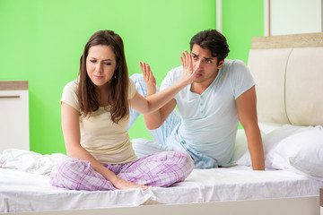 Woman and man in the bedroom during conflict
