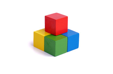 multi colored wooden block on white background