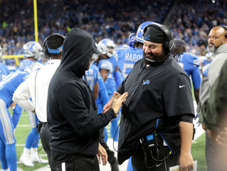 American rapper Marshall Mathers, professionally known as Eminem, greets Detroit Lions head coach Matt Patricia  before their NFL game against the New York Jets in Detroit,
