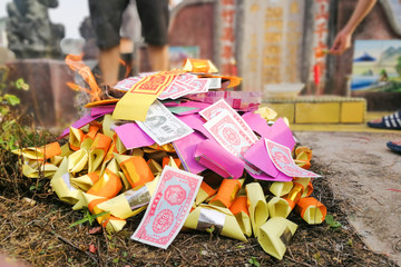 Burning paper money and other offerings during qingming in Malaysia