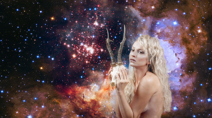Woman with horns. Capricorn Zodiac Sign on on night sky background