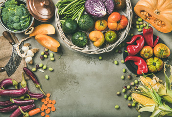 Healthy vegetarian seasonal Fall food cooking background. Flat-lay of Autumn vegetables from local market over grey concrete table background, top view, copy space. Vegan, dieting, alkaline diet food Wall mural