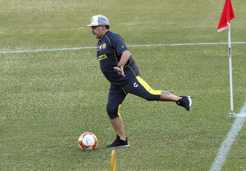 Argentinian soccer legend Diego Armando Maradona kicks the ball during his first training session as coach of Dorados at the Banorte stadium in Culiacan, in the Mexican state of Sinaloa