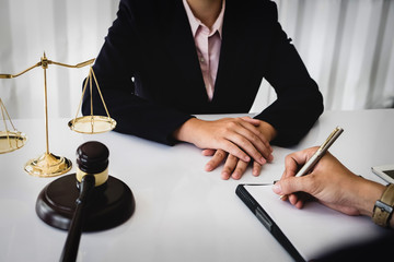 notary consultant concept , Judge gavel with client negotiation or discussion lawyer lawsuit bankruptcy of business her. Concepts of law.