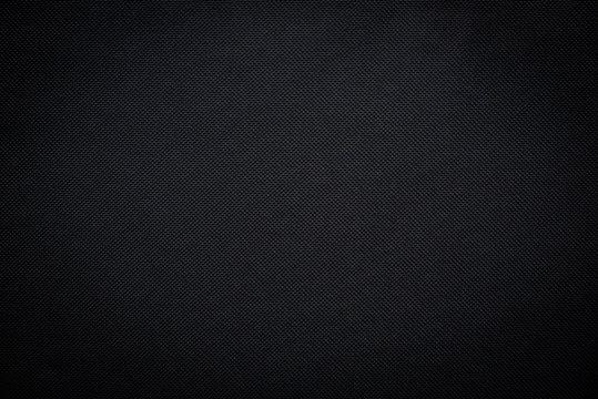 Black woven carbon fiber sheet texture background