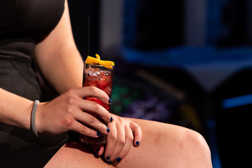 woman hands holding red cocktail