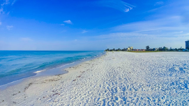 The beach on Siesta key beach with white sand.
