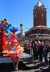 Drag queens wearing costumes ride a float travelling down the main street during the annual Broken Heel Festival in the outback town of Broken Hill in western New South Wales