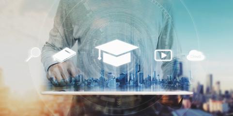 Fototapeta Online education, e-learning and e-book concept. a man using digital tablet for education, with education and online learning media icons obraz