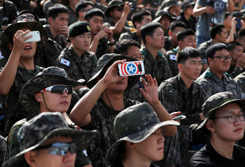 A South Korean soldier takes a photograph during a demonstration at a media event of 2018 Defense Expo Korea near the demilitarized zone separating the two Koreas in Pocheon