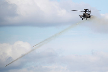 A South Korean army Apache helicopter fires missiles during a demonstration at a media event of 2018 Defense Expo Korea near the demilitarized zone separating the two Koreas in Pocheon