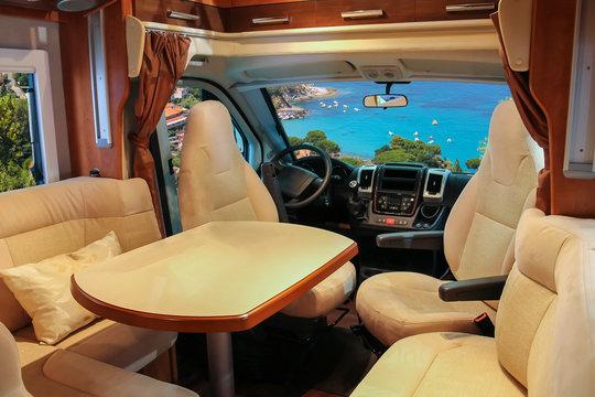 Luxury salon of comfortable camper near the sea shore