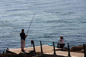 Fishing in the Mediteranean sea from a jetty in Majorca.