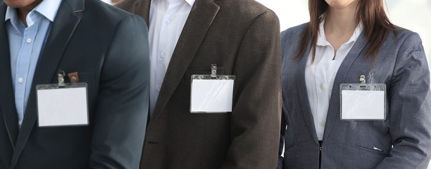 group of business people with blank badges