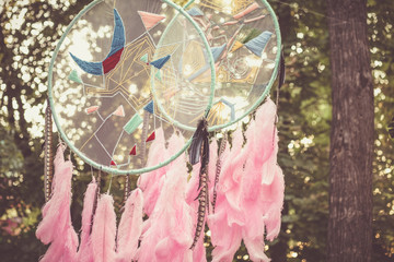 Dreamcatcher garden decoration with pink feathers