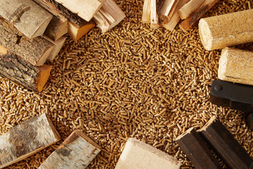 Background of mounds of pegs and chopped logs