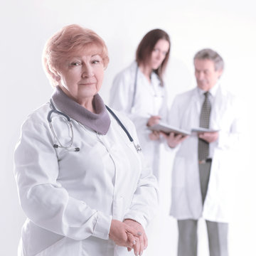 adult female doctor therapist on blurred background of colleagues