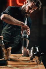 Spoed Foto op Canvas Barista Brewing Aeropress Coffee