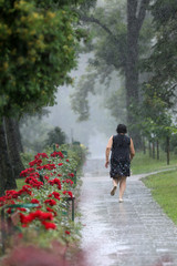 An elderly woman got wet after a sudden rain.