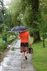 An elderly woman got wet after a sudden rain