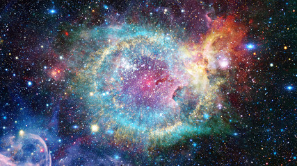 The Helix Nebula in deep space. Elements of this image furnished by NASA.