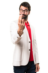 Brunette man with glasses doing coming gesture on white background