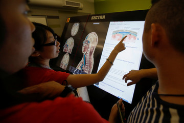 First-year medical student Doris Chan makes a point as she participates with classmates in the virtual anatomy class at the UNLV School of Medicine in Las Vegas