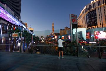A tourist takes a picture above the Las Vegas Strip in Las Vegas