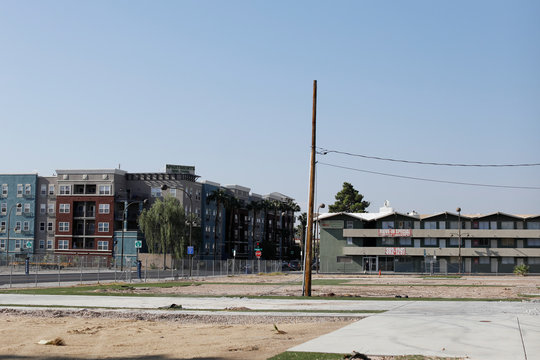 An old apartment building, empty lot and a new modern construction are shown in a neighborhood  in Las Vegas