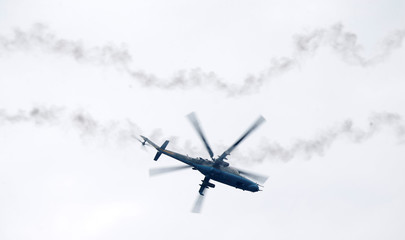 Mi-24 helicopter flies over a shooting range during the military exercise near the city of Borisov