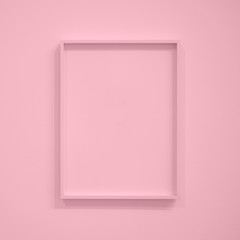 Empty pastel pink frame on pink wall for interior decoration. Minimal concept.