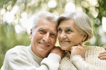 Portrait of elderly couple together in park