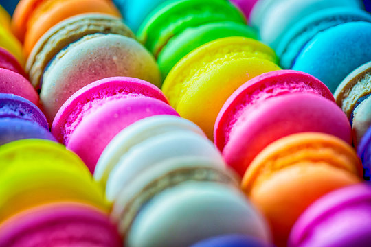 Colorful macrons dessert with vintage pastel tones. Colorful french macarons background,Different colorful macaroons background.Tasty sweet color macaron,Bakery concept.Selective focus.