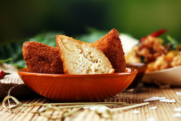 Coxinha street food. Brazilian Chicken Coxinha over rustic background.